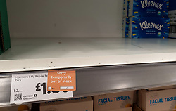 © Licensed to London News Pictures. 09/10/2021. London, UK. 'Sorry temporarily out of stock' label on display on the tissue paper boxes shelf in Morrisons, north London amid fears of shortage of essential items leading up to Christmas due to labour shortages following Brexit. According to figures from the Office of National Statistics, one in six people in the UK have been unable to buy essential foods in the past two weeks and the Army could be drafted in to drive HGVs over Christmas as the supply chain crisis continues. Photo credit: Dinendra Haria/LNP