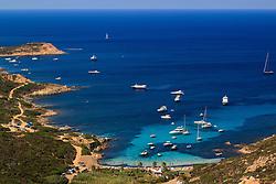 La Golfe de La Revellata just outside Calvi in Corsica. Boats and bathers relax in the calm, clear turquoise water of the Mediterranean Sea.