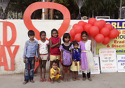 November 30, 2016 - Kolkata, West Bengal, India - Children during the awarness campaign in Kolkata. Thalasaemia and AIDS Prevention Society member organize a awareness program on eradication of HIV/AIDS and its stigma, panic and discrimination from our society ahead of Worlds AIDS day. World AIDS day is observed annually on December 1 to raise awareness about HIV/AIDS and to demonstrate solidarity in the face of pandemic. (Credit Image: © Saikat Paul/Pacific Press via ZUMA Wire)