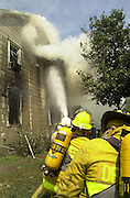 SPOT NEWS   9/19/02   BEVERLY CITY.Firefighters from 4 towns battled high temps as the fought this 2 alarm fire in Beveryly City on Monday Afternoon (PHOTO BRYAN WOOLSTON)