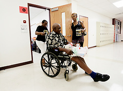 September 9, 2017 - City, Florida, U.S. - OCTAVIO JONES   |   Times .Deborah Clay, right, holds the door for her step-mother Joanne Clay, 62, left, while helping her husband John Clay, 83, with finding shelter at Middleton High School in Tampa on Saturday, September 9, 2017. Over 900 people are taking shelter from Hurricane Irma at Middleton High School. (Credit Image: © Octavio Jones/Tampa Bay Times via ZUMA Wire)