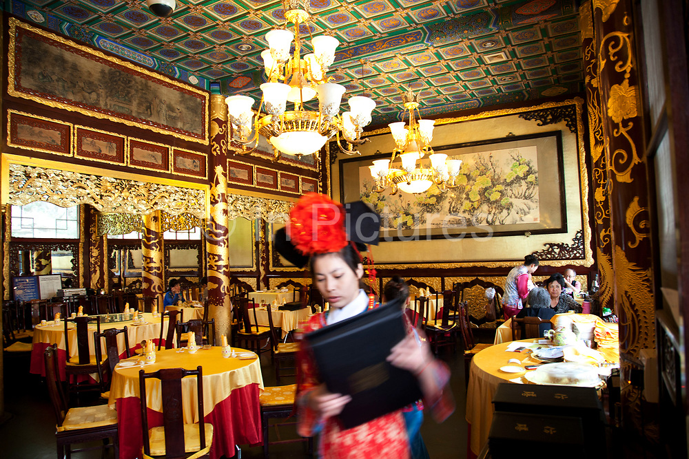 Fangshan Restaurant is famous for cooking imperial cuisine and has a history of nearly more than 80 years. In 1925, Beihai Park was opened to the public and established a tea house as 'Fangshan'. In 1955, Fangshan Tea House was changed from the private sector into the state, and it was renamed as 'Fangshan Restaurant'. During1966 to 1977, Beihai Park stopped opening to the outside world, Fangshan ceased operation. During this time, it became a place where party and state leaders met foreign guests, and handled administrative affairs. In 1978, Beihai Park was re-opened. Fangshan Restaurant was also resumed for business. The opulent dining rooms and staff in traditional dress give a truly unique atmosphere. The food itself is creative and modern with a great deal of history behind it. This restaurant is somewhere where you can hold a Man Han banquet.