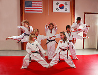 7 February 2008:  Tae Kwon Do student athletes in motion. Young kids practicing Taekwondo at the USA Black Belt Academy in Huntington  Beach, CA. Tae Kwon Do is a Korean Martial Art discipline that trains the body and mind.  It is global sport that is an official Olympic sport. ? Background Retouched *