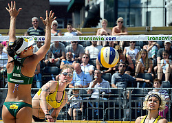 17-07-2014 NED: FIVB Grand Slam Beach Volleybal, Apeldoorn<br /> Poule fase groep G vrouwen - Agatha Bednarczuk, Laura Ludwig and Julia Sude from Germany