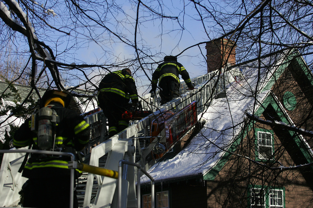 Brookline, MA 01/17/2011.Brookline firefighters combat a structure fire at 71 Griggs Rd in Brookline on Monday morning.Alex Jones / www.alexjonesphoto.com