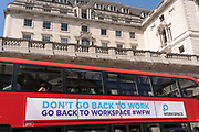 Now that workers are gradually returning to their office workplaces after a year of Covid lockdown restrictions,  a banner on the side of a London bus advertises the property company Workspace, alongside the Bank of England in the City of London, the capitals financial district, on 8th June 2021, in London, England. Workspace is a real estate investment trust that  lets office, industrial and workshop space to small and medium-sized enterprises.