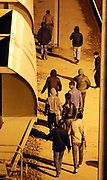 Migrants walk along the railway track leading to the EuroTunnel at night, in Calais, France, August 10, 2015. Migrants are attempting to enter the United Kingdom illegally by stowing away on lorries, ferries, cars, or trains travelling through the Port of Calais or the Eurotunnel Calais Terminal. The migrants are a mix of refugees, asylum seekers and economic migrants from Darfur, Afghanistan, Syria, Iraq, Eritrea and other troubled areas of the world.