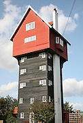 The House in the Clouds, Thorpeness, Suffolk, England.<br /> Essentially a water tower for the holiday village of Thorpeness constructed by Braithwaite Engineering Company of London in 1923 for Glencairne Stuart Ogilvie. The water tower was brilliantly disguised as a house and from miles around one can see what appears to be a cottage lodged in the trees.