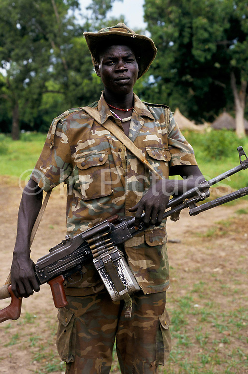 SPLA, Sudan People's Liberation Army, soldier wearing camouflage combat uniform, carrying an automatic weapon, Rumbek, Lake States, Southern Sudan.
