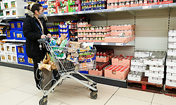 © Licensed to London News Pictures. 15/01/2021. London, UK. A shopper in Lidl supermarket in north London. Lidl is named the cheapest supermarket of 2020, according to Which? The consumer group tracked 45 own-label and branded products in eight major supermarkets for at least 100 days between January and December 2020 and Lidl was the cheapest supermarket in the study, with the basket costing £42.67 on average. Photo credit: Dinendra Haria/LNP