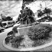 """""""The Pioneers"""" sculpture group at Pioneer Park at Westport Rd and Broadway, Kansas City, Missouri."""