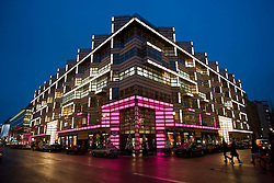 Evening view of exterior of Quartier 206 upmarket shopping mall on Friedrichstrasse in Mitte Berlin 2009