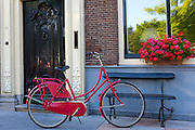 Quaint canalside house facade, 16th century, with traditional bicycle in Edam, The Netherlands