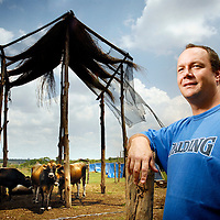 """Outskirts of Chimoio, Manica province, Mozambique, (90 km away from the border with Zimbabwe) <br /> 21 November 2007<br /> Brandon Evans, 35 years old, whose farm was attacked by Mugabe's """"war veterans"""". Mr. Evans was one of the first Zimbabwean farmers settling in Mozambique, where he produces dairy products in a property of 1200 hectares rented by the government. He said to the journalist:  """" Since the year 2000 the situation in Zimbabwe does not allow us to dedicate ourselves to agriculture. It would be a total madness to buy a property there, knowing that there is a strong possibility that it would be taken away from me. For this reason I installed my business in Mozambique """"<br /> Photo: Ezequiel Scagnetti"""