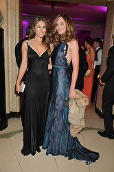Left to right, ELIZABETH HURLEY and TRINNY WOODALL at the QBF Spring Gala in aid of the Red Cross War Memorial Children's Hospital hosted by Heather Kerzner and Jeanette Calliva at Claridge's, Brook Street, London on 12th May 2015.