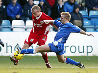 Photo: Chris Ratcliffe.<br />Gillingham v Bristol City. Coca Cola League 1. 26/12/2005.<br />Dave Cotterill of Bristol (L) tries to cross as Danny Jackman of Gillingham closes him down.