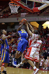 06 December 2008: Kellen Thornton ties up a shot being offered by Leon Buchanan during a game where the  Illinois State University Redbirds extended their record to 9-0 with a 76-70 win over the Eagles of Morehead State on Doug Collins Court inside Redbird Arena on the campus of Illinois State University in Normal Illinois