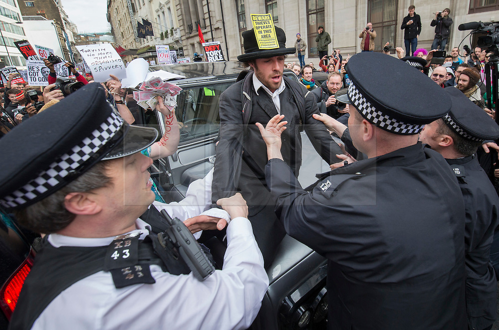 © Licensed to London News Pictures. 09/04/2016. London, UK. A protester is pulled from a Conservative supporter's Land Drover as a tax reform demonstration reaches the Conservative Spring Conference at the Connaught Rooms. Photo credit: Peter Macdiarmid/LNP