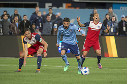 April 29, 2018 - Bronx, New York, United States - New York City forward DAVID VILLA (7) gets past FC Dallas defender RETO ZIEGLER (3) and FC Dallas defender MATT HEDGES (24) to score his second goal during a regular season match at Yankee Stadium in Bronx, NY.  NYCFC defeats FC Dallas 3 to 1. (Credit Image: © Mark Smith via ZUMA Wire)