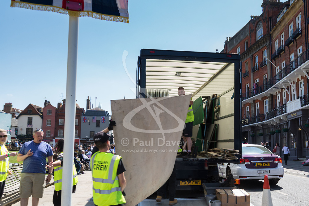 Workers dismantle a temporary TV studio outside Windsor Castle on the day following the wedding of Prince Harry to Meghan Markle in Windsor, Berkshire. WINDSOR, May 20 2018.