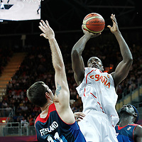 02 August 2012: Spain Serge Ibaka takes a jumpshot over Great Britain Joel Freeland during 79-78 Team Spain victory over Team Great Britain, during the men's basketball preliminary, at the Basketball Arena, in London, Great Britain.
