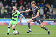 Forest Green Rovers Carl Winchester(7) passes the ball forward during the EFL Sky Bet League 2 match between Forest Green Rovers and Lincoln City at the New Lawn, Forest Green, United Kingdom on 2 March 2019.