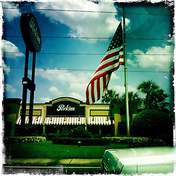 American flag on International Drive. Orlando holiday 2012. Photo taken with the Hipstamatic photo application on Apple iPhone 4.