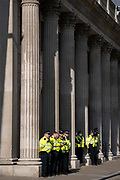 Police officers guard the Bank of England as climate Change Extinction Rebellion protesters concerned about the fossil fuel economy occupy Bank in the City of London, the capitals financial district, on 2nd September 2021, in London, England.