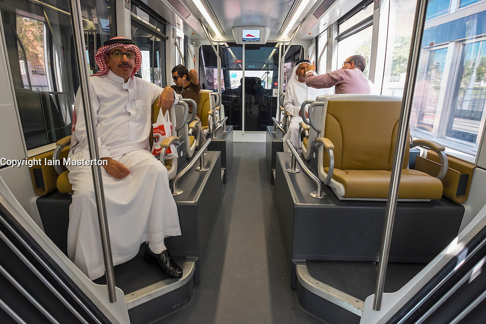 Interior of Gold Class carriage of tram with passengers on new Dubai Tram system in Marina district of Dubai United Arab Emirates
