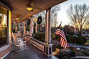 Late afternoon winter sunlight bathes the porch of an elegant Queen Anne Victorian property in Asheville, North Carolina, USA. (photo by ChristopherPillitz/In Pictures via Getty Images)