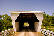 """14 SEPTEMBER 2020 - WINTERSET, IOWA: The Cedar Bridge in Madison County was built in 1883. It has been destroyed twice by fire, most recently in 2017, and rebuilt each time. The covered bridges of Madison County are an enduring tourist attraction more than 25 years after the book and movie """"The Bridges of Madison County"""" made them famous. There are six covered bridges in Madison County, all built in the 1800s. They are remnants of about 100 covered bridges built in Iowa from the 1850s through the late 1800s. Most of the briges were washed away in floods, condemned, or destroyed in fires. The Madison County bridges have been restored and rebuilt through the years.    PHOTO BY JACK KURTZ"""