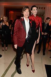 SIR MICK JAGGER and L'WREN SCOTT at the Harper???s Bazaar Women of the Year 2013 in association with Estée Lauder, Audemars Piguet and Selfridges & Co. held at Claridge's, Brook Street, London on 5th November 2013.