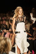 A white  dress with black lace accents at the BCBGMAXAZRIA show at the Spring 2013 Mercedes Benz Fashion Week show in New York.
