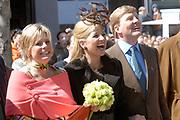 Her Majesty the queen and members of the royal family celebrate Saturday 29 April 2006 Queensday in the province flevoland in the cities  Zeewolde and almere.<br /> <br /> Hare Majesteit de Koningin en leden van de Koninklijke Familie vieren zaterdag 29 april 2006 Koninginnedag mee in de provincie Flevoland en wel in Zeewolde en Almere.<br /> <br /> On the Photo / Op dce foto: Princes Laurentien , Princes Maxima and Willem Alexander lookingf at virtual biting-the-cake. / Princes Laurentien , Princes Maxima Willem Alexander kijken naar het virtueel koekhappen.