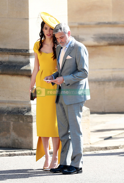 US actor George Clooney (R) and his wife, British human rights barrister Amal Clooney arrive for the royal wedding ceremony of Britain's Prince Harry and Meghan Markle at St George's Chapel in Windsor Castle, in Windsor, Britain, 19 May 2018. Photo by Lauren Hurley/ABACAPRESS;COM