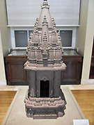 Sandstone miniature Hindu temple Possibly from Benares, northern India, late 18th or early 19th century AD. This miniature temple is composed of three sections. It is typical of the later north Indian or nagara style of Indian temple architecture. Raised on a moulded basement, the main shrine of a Hindu temple consists of a small, square chamber with a single entrance. Inside is an image of the temple's deity, in this case a linga, the symbolic, phallic emblem of Shiva. Above the doorway is a small image of Ganesha, the remover of obstacles, who often appears at the entrance to temples
