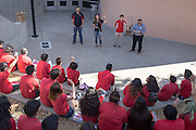 Patrick Arite and Monica Nezzer (black shirts) stand with fellow tour guide Alexander Gordon and Student Recruitment Specialist Mario Vega as they greet the group on Thursday June 2, 2016. Arite and Nezzer and are both students at the University of New Mexico and are working 15-30 hours per week giving campus tours in order to help put themselves through college. (Steven St. John for NPR)