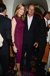 RICCARDO & COSIMA PAVONCELLI at an exhibition of the 50 best party pictures from Tatler from the past 50 years, held at Annabel's, Berkeley Square, London on 9th September 2013.