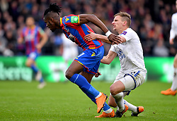 Leicester City's Marc Albrighton (right) pulls back Crystal Palace's Wilfried Zaha resulting in a red card from referee Mike Dean during the Premier League match at Selhurst Park, London.