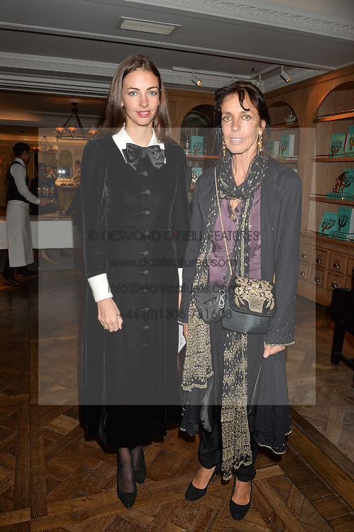 Left to right, the MARCHIONESS OF CHOMONDELEY and her mother EMMA HANBURY at a party hosted by Ewan Venters CEO of Fortnum & Mason to celebrate the launch of The Cook Book by Tom Parker Bowles held at Fortnum & Mason, 181 Piccadilly, London on 18th October 2016.