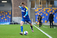 AFC Wimbledon midfielder Jack Rudoni (12) about to pass the ball during the EFL Sky Bet League 1 match between AFC Wimbledon and Milton Keynes Dons at Plough Lane, London, United Kingdom on 30 January 2021.