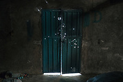 A door is riddled by bullet holes in Titila, a town near Ayahualtempa, Guerrero, that has been abandoned because of violence. Murders in Mexico rose to a new record in 2019, the first full year of Andres Manuel Lopez Obrador's presidency, posing a challenge to the popular leader to make good on a campaign promise of reducing violence.