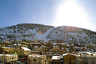 sun setting over hill in Old Town Park City, Utah in winter
