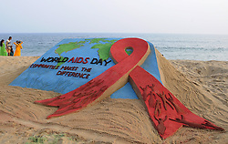 May 11, 2002, Bhubaneswar, India: An awareness sand sculpture is seen at the Bay of Bengal Sea's eastern coast beach as it is creating by sand artist Manas Sahoo for visitors awareness about the World AIDs Day, 65 km away from the eastern Indian state Odisha's capital city Bhubaneswar. (Credit Image: © Str/NurPhoto via ZUMA Press)