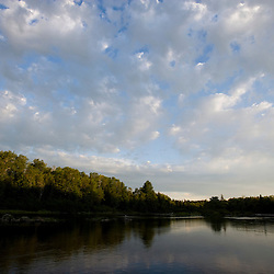 Morning clouds above the Moose River, just below Brassua Lake in Maine's Northern Forest.
