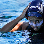 Diana Ramirez of Fullerton College puts on her game cap before the second game of Orange Empire Conference Water Polo Championships. November 3rd, 2016, 10:20am — Orange Coast College vs Saddleback College — Women's Waterpolo — Saddleback College, Mission Viejo, CA<br /> <br /> Photo by Austin Song / Sports Shooter Academy
