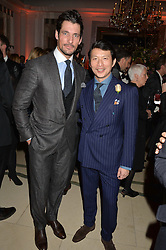 Left to right, DAVID GANDY and WEI KOH at a reception hosted by The Rake Magazine and Claridge's to celebrate London Collections 2015 held at Claridge's, Brook Street, London on 8th January 2015.