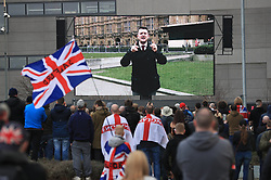 "© Licensed to London News Pictures . 23/02/2019. Salford, UK. Supporters of Tommy Robinson (real name Stephen Yaxley-Lennon ) and anti-fascists opposed to the former EDL leader and his followers , gather near to the BBC at Media City to protest , as Yaxley-Lennon hosts a rally showing a home-made documentary , "" Panodrama "" , described as an exposé of the BBC's Panorama documentary series . A BBC Panorama documentary is due to feature an investigation in to Yaxley-Lennon in the near future . Photo credit: Joel Goodman/LNP"
