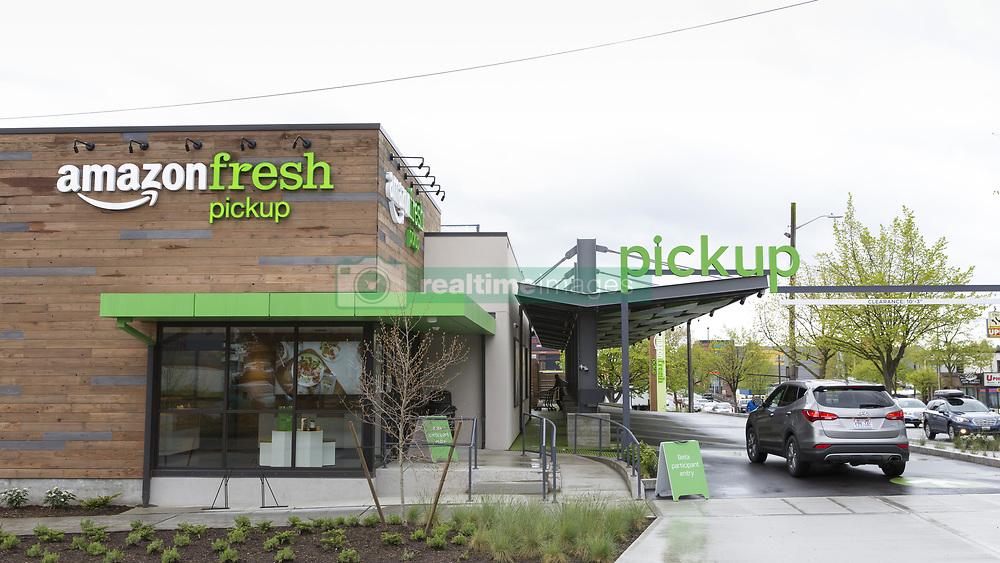 April 26, 2017 - Seattle, Washington/King County, United States - Seattle, Washington: AmazonFresh Pickup Ballard. A customer drives into the AmazonFresh Pickup in the Ballard neighborhood. Now in its second month of a beta test program, AmazonFresh Pickup is available for Amazon employees. Amazon.com currently has two grocery pickup locations in Seattle's SoDo and Ballard neighborhoods where shoppers can receive their online purchases in as little as fifteen minutes after they are placed. All Amazon Prime members will have free and unlimited pickup benefits once opening to the public at a later date. (Credit Image: © Paul Gordon via ZUMA Wire)