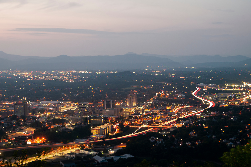 Light trails from traffic traveling along Interstate 581 around downtown Roanoke, Virginia on Sunday, August 26, 2018. Copyright 2018 Jason Barnette